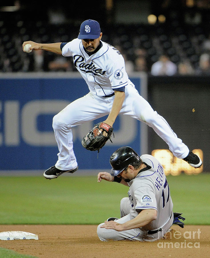 Jason Bartlett And Todd Helton Photograph by Denis Poroy