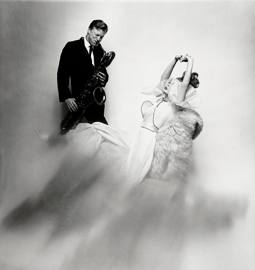 Jazz Musician Gerry Mulligan and model Monique Chevalier Photograph by Bert Stern