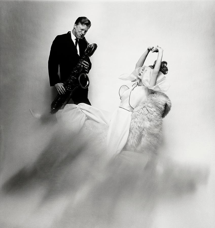 Jazz Musician Gerry Mulligan and model Monique Chevalier Photograph by Bert Stern