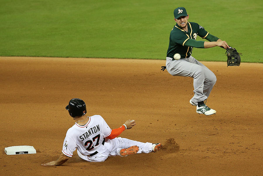 Jed Lowrie And Giancarlo Stanton Photograph by Mike Ehrmann