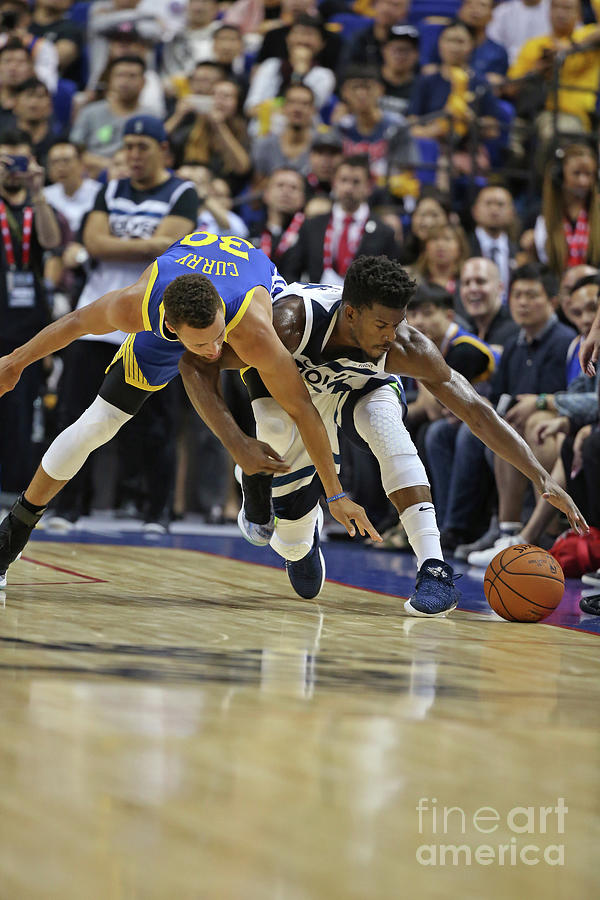 Jimmy Butler and Stephen Curry Photograph by David Sherman