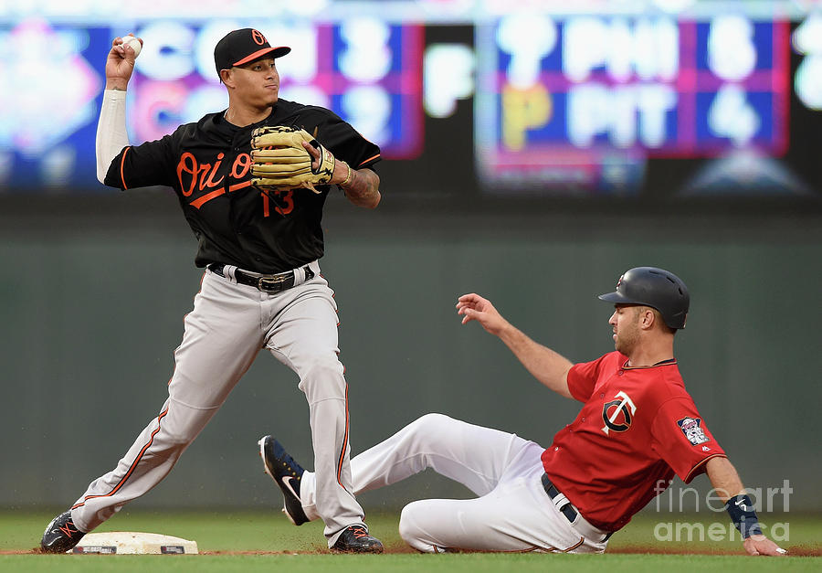 Joe Mauer and Manny Machado Photograph by Hannah Foslien