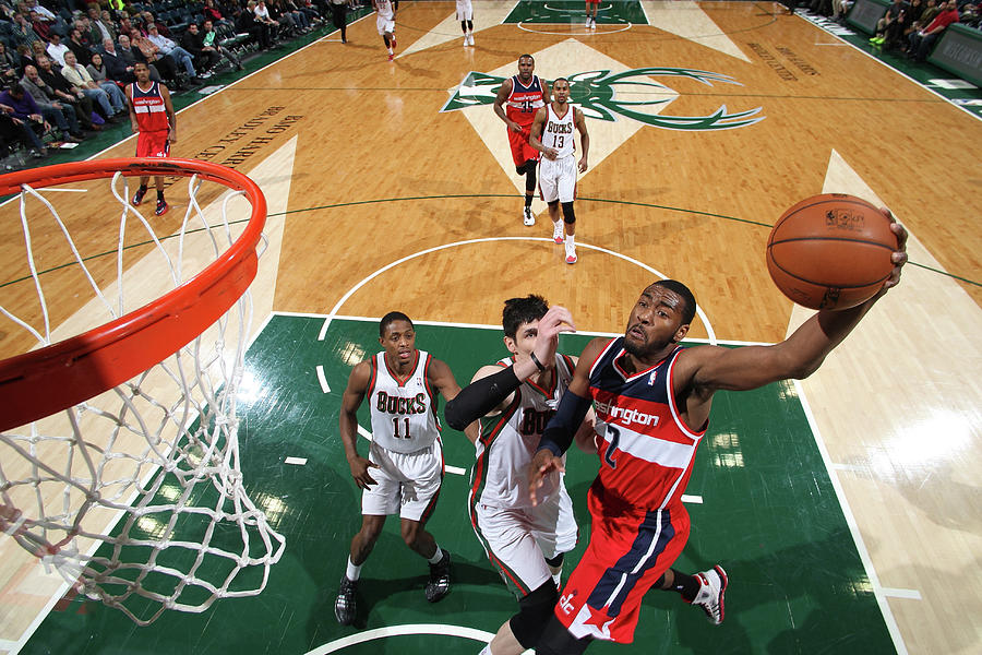 John Wall and Ersan Ilyasova Photograph by Gary Dineen