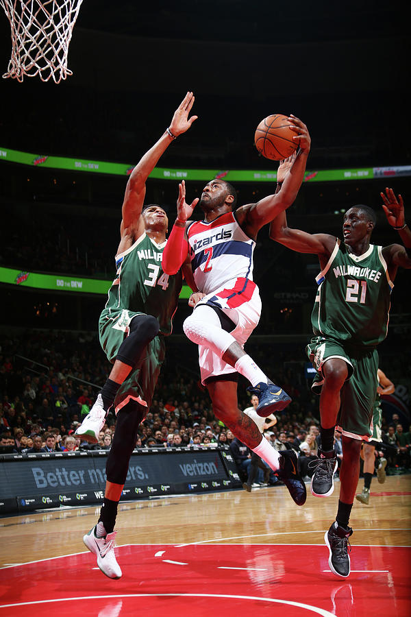 John Wall and Giannis Antetokounmpo Photograph by Ned Dishman