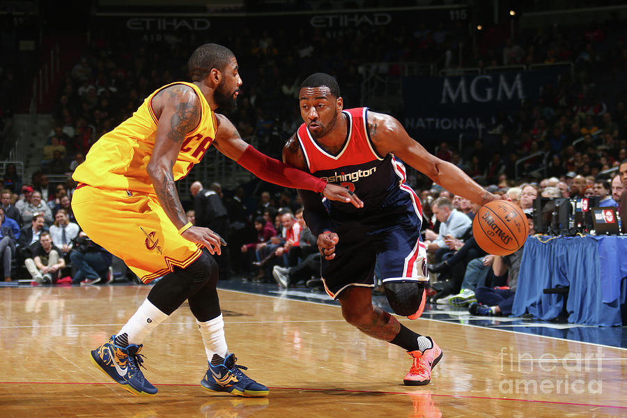John Wall and Kyrie Irving Photograph by Ned Dishman