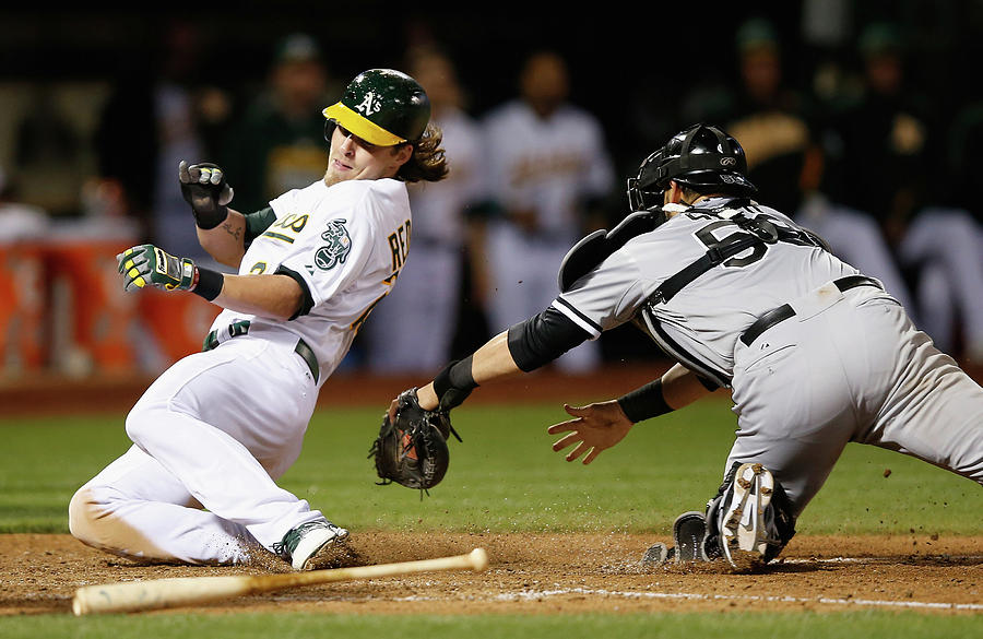 Josh Reddick, Billy Butler, and Geovany Soto Photograph by Ezra Shaw