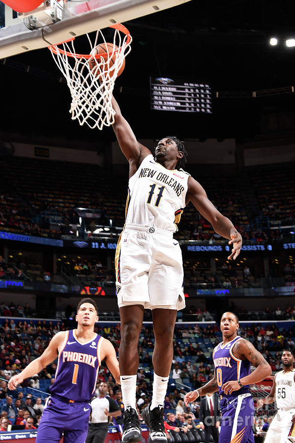 Jrue Holiday Photograph by Bill Baptist
