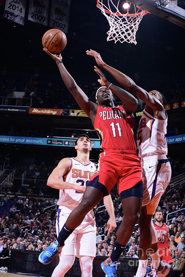 Jrue Holiday Photograph by Michael Gonzales