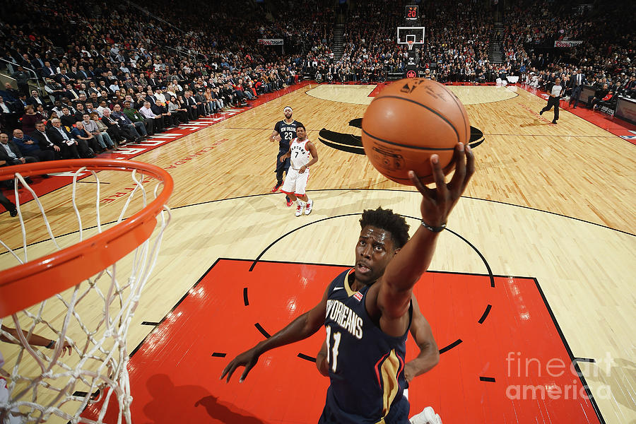 Jrue Holiday Photograph by Ron Turenne