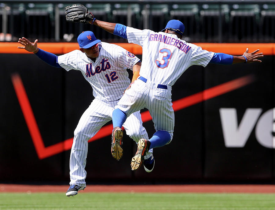 Juan Lagares And Curtis Granderson Photograph by Elsa