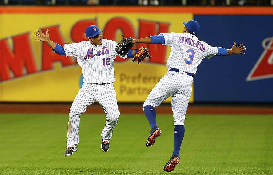Juan Lagares and Curtis Granderson Photograph by Jim Mcisaac