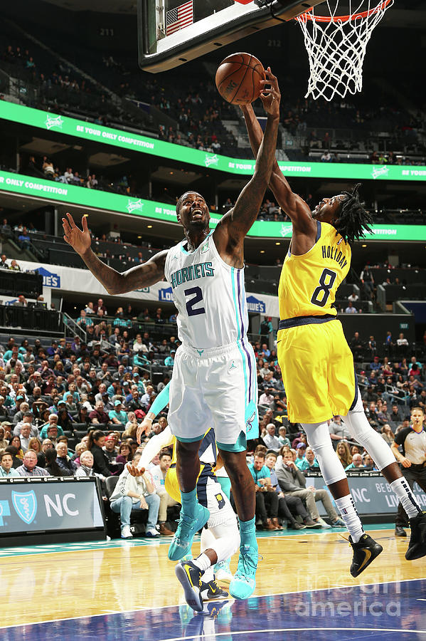 Justin Holiday and Marvin Williams Photograph by Kent Smith