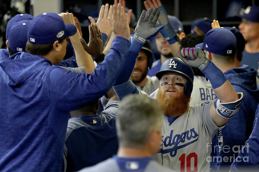 Justin Turner And Jeremy Jeffress Photograph by Rob Carr