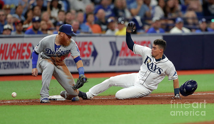 Justin Turner and Willy Adames Photograph by Mike Carlson