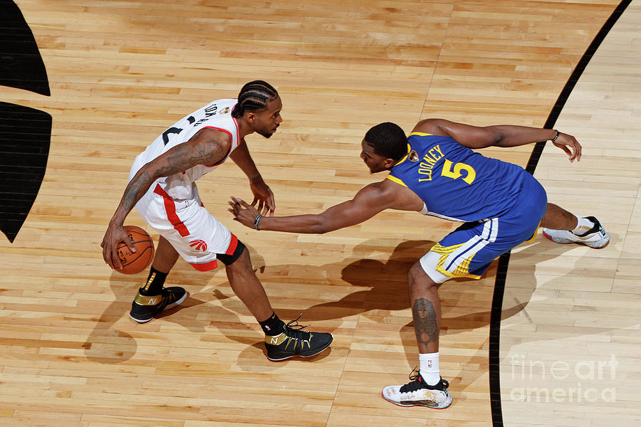 Kawhi Leonard and Kevon Looney Photograph by Mark Blinch