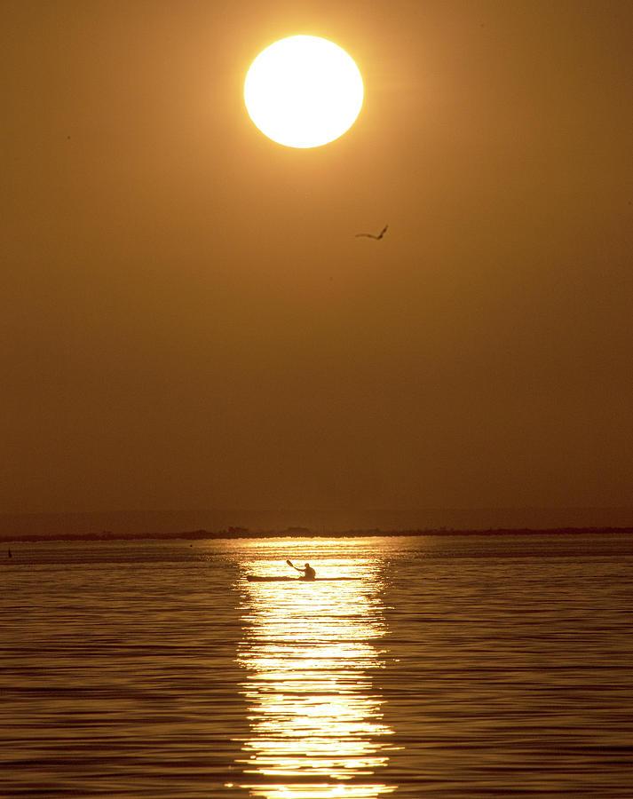 Kayaking Photograph - Kayaking in golden light. by Leigh Henningham