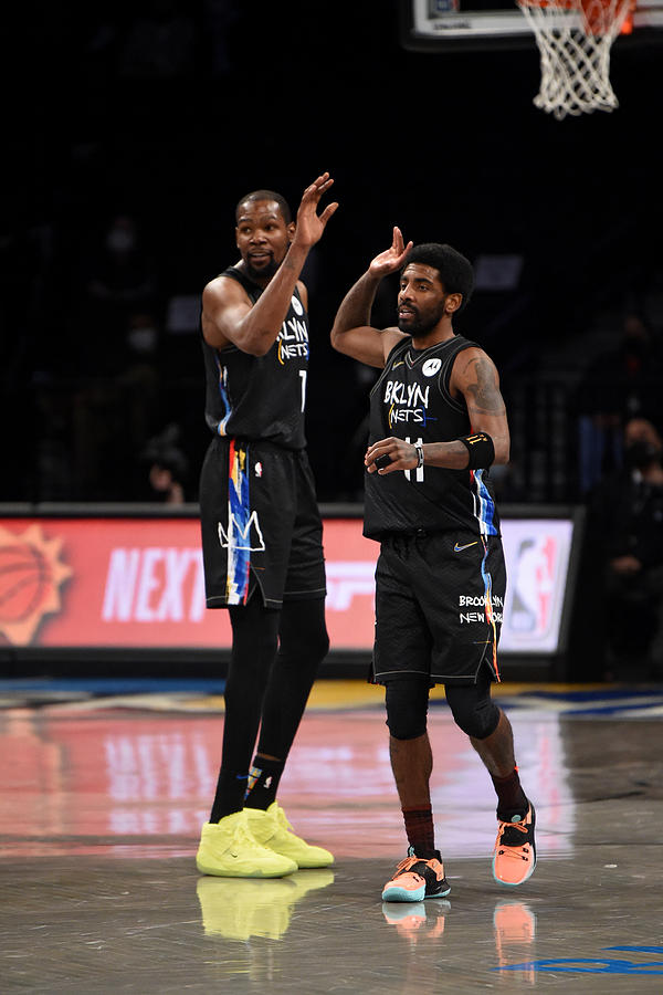 Kevin Durant and Kyrie Irving Photograph by David Dow