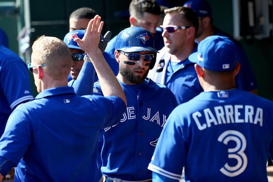 Kevin Pillar and Ezequiel Carrera Photograph by Tom Pennington