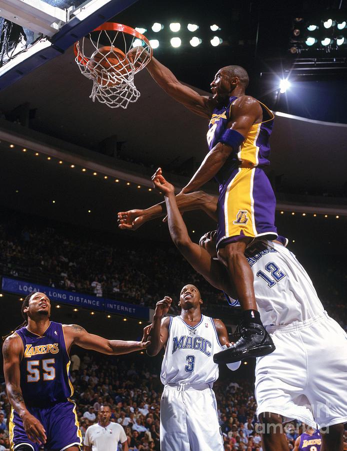 Kobe Bryant and Dwight Howard Photograph by Fernando Medina