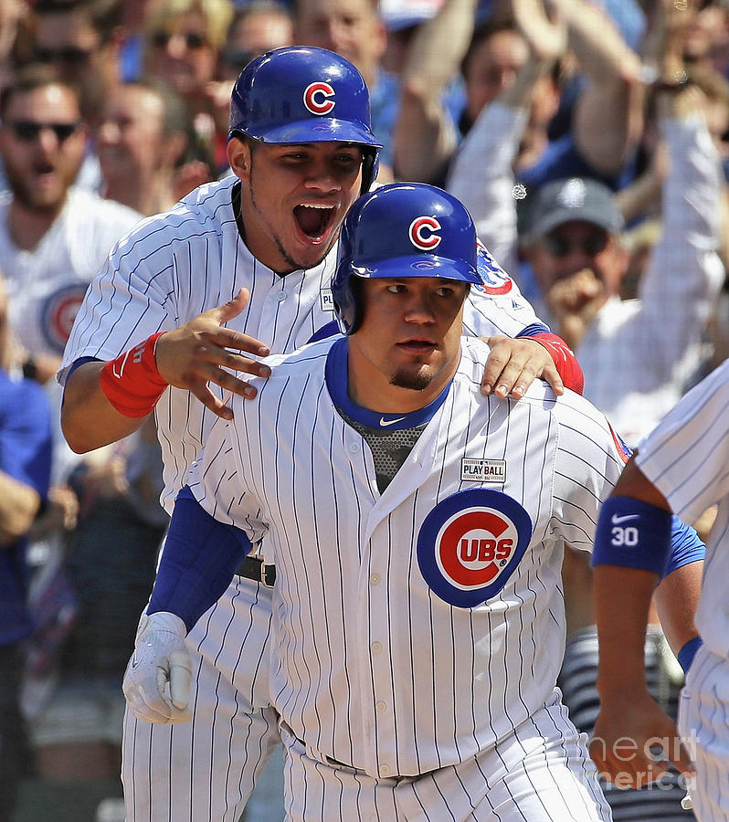 Kyle Schwarber And Willson Contreras Photograph by Jonathan Daniel