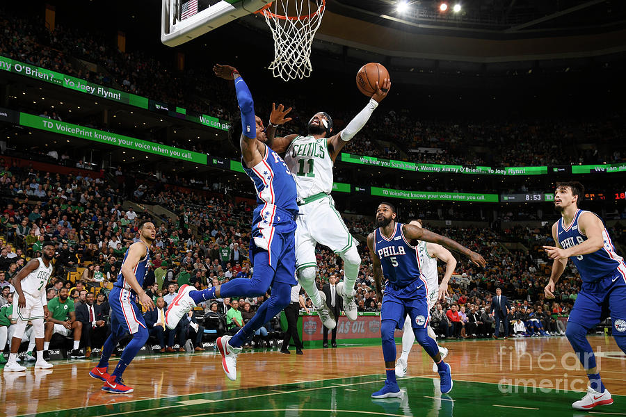 Kyrie Irving and Robert Covington Photograph by Brian Babineau