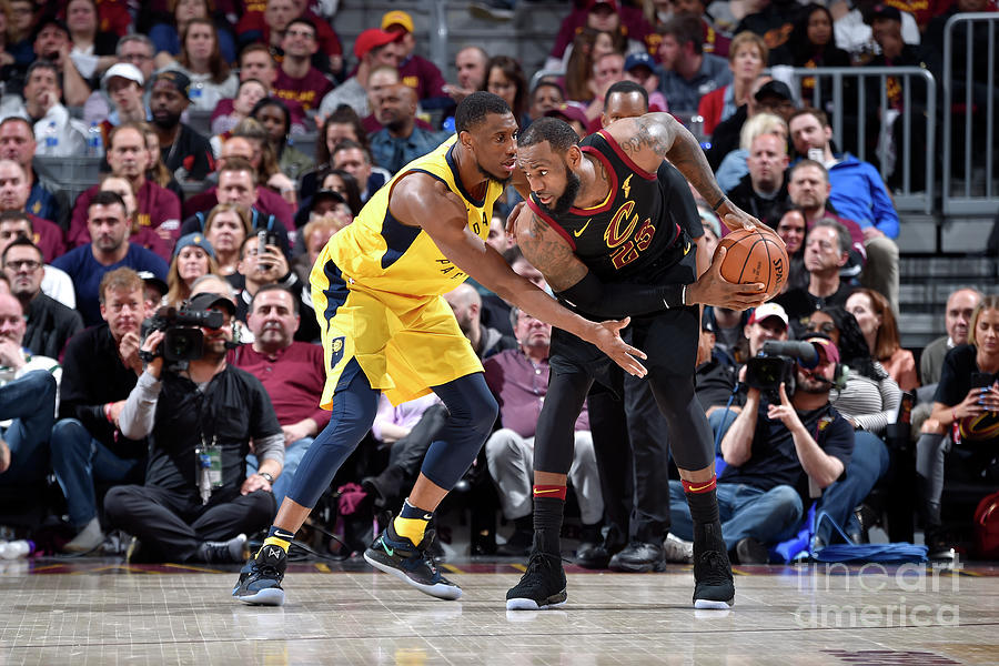 Lebron James and Thaddeus Young Photograph by David Liam Kyle