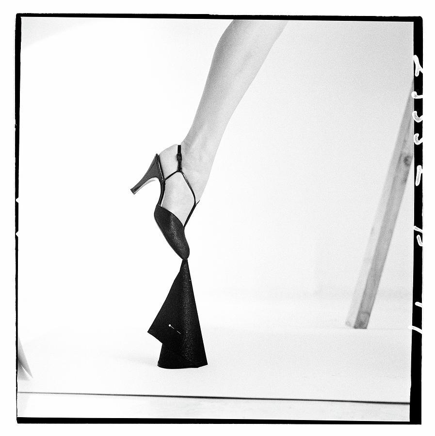 Leg Of A Model Wearing a T-Strap Sandal Photograph by Richard Rutledge
