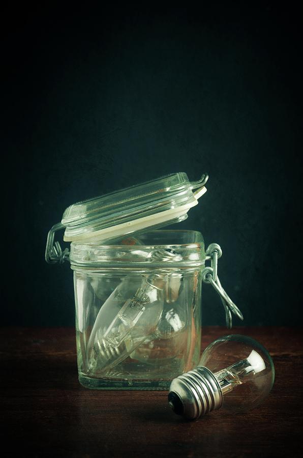 Light Bulbs and Glass Jar by Carlos Caetano