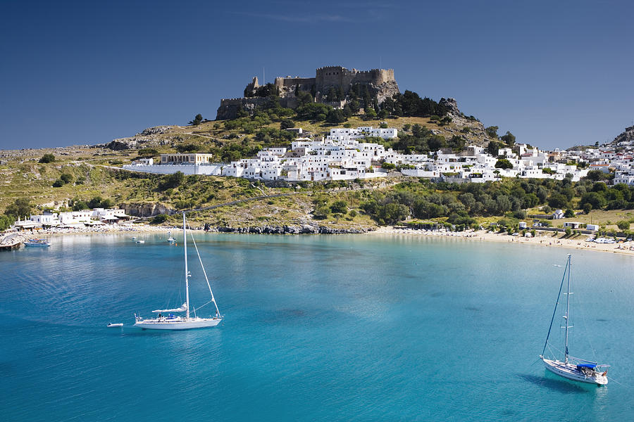 Lindos with beach + Acropolis Photograph by Jorg Greuel