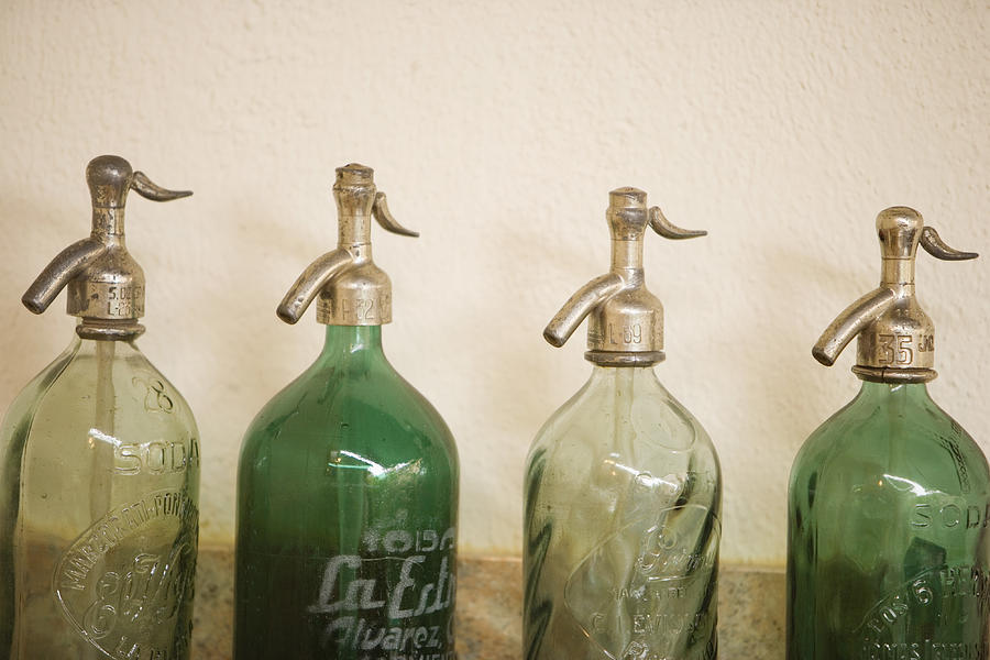 Line of Antique Pouring Bottles Photograph by LOOK Photography