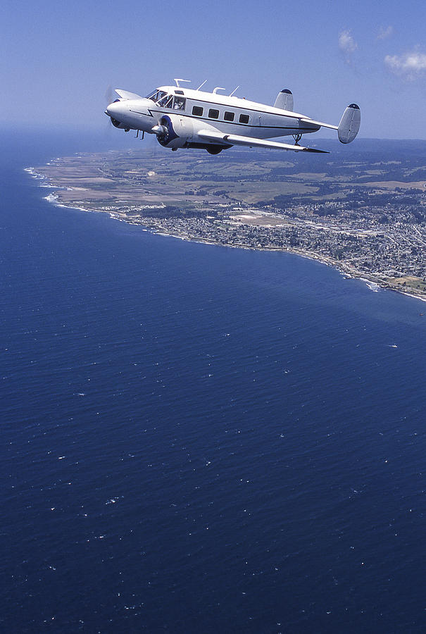 Lockheed 10 Electra Flying Over Coast Photograph by GomezDavid