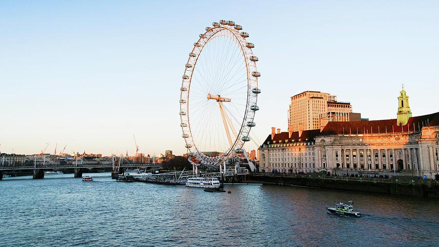 London Eye beautiful sundown near river thames by Santosh Puthran