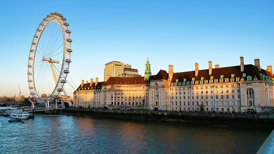 London Eye Gorgeous sundown near river thames by Santosh Puthran