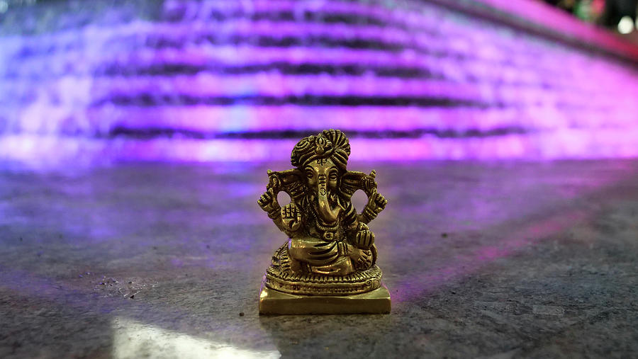 Lord Ganesha at Winter Lights show 2020 at Canary Wharf pink background by Santosh Puthran