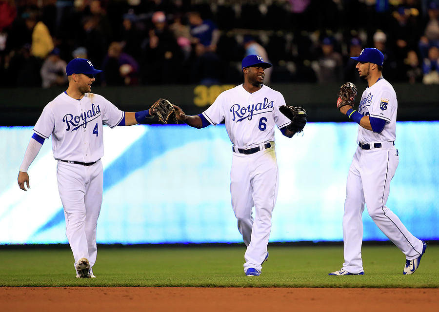 Lorenzo Cain, Alex Gordon, and Paulo Orlando Photograph by Jamie Squire