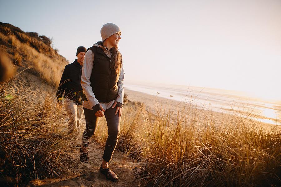 Loving Mature Couple Hiking At Oregon Coast Photograph by RyanJLane