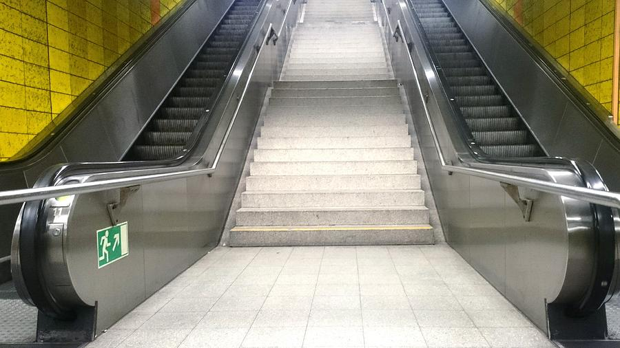 Low Angle View Of Steps Amidst Escalators In Subway Photograph by Roman Pretot / EyeEm