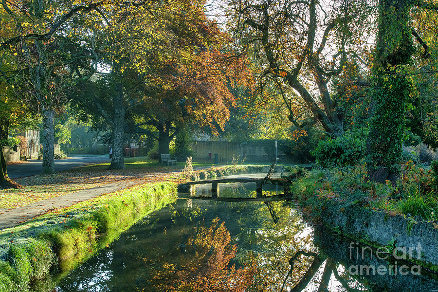 Lower Slaughter Stone Bridge in Autumn by Tim Gainey
