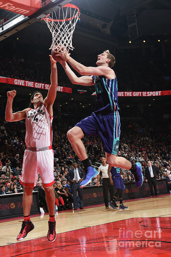 Luis Scola and Cody Zeller Photograph by Ron Turenne