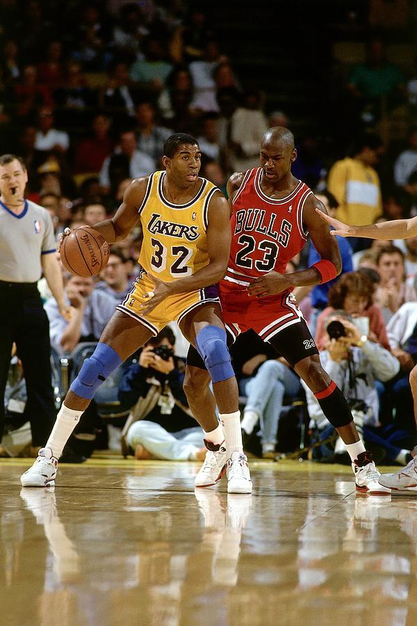Magic Johnson and Michael Jordan Photograph by Andrew D. Bernstein