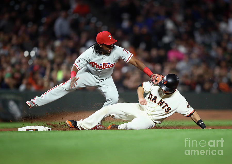 Maikel Franco and Buster Posey Photograph by Ezra Shaw