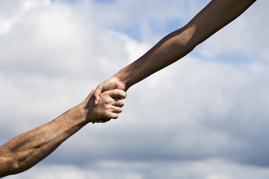 Man and woman outdoors clasping hands, close-up Photograph by Andy Andrews
