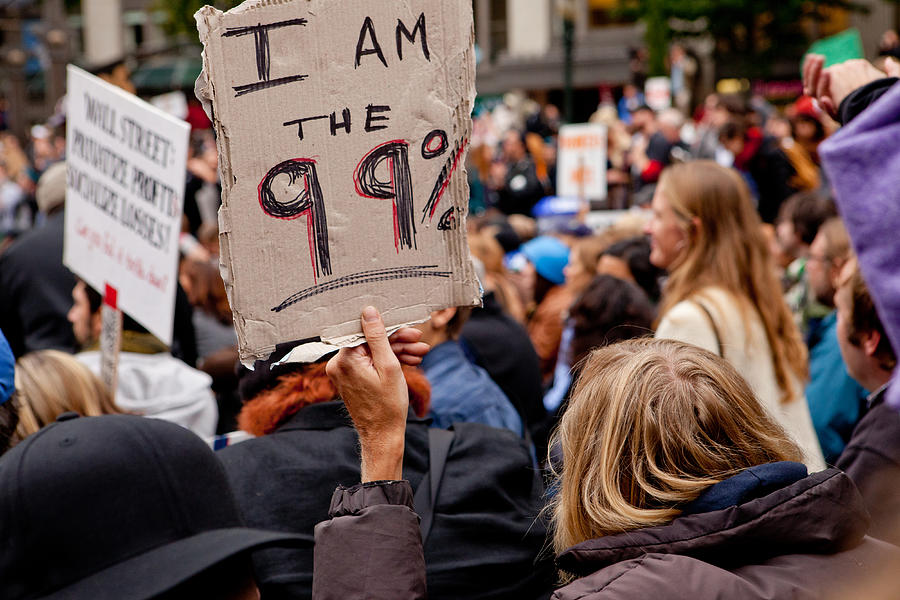 Man holding a sign that says I am the 99% Photograph by Andipantz