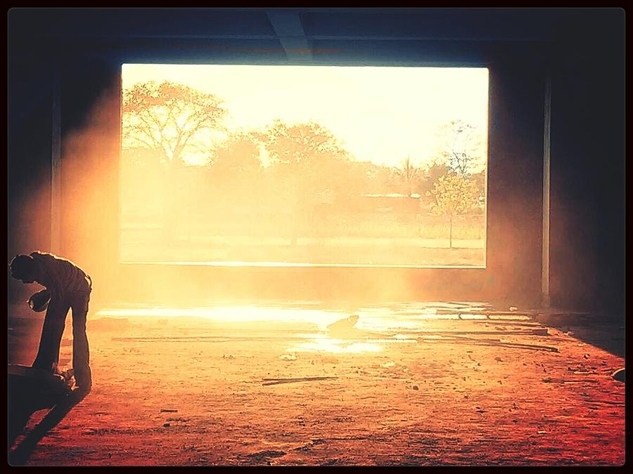 Man In Deserted Building In Sunlight Photograph by Sagar Pujari / EyeEm