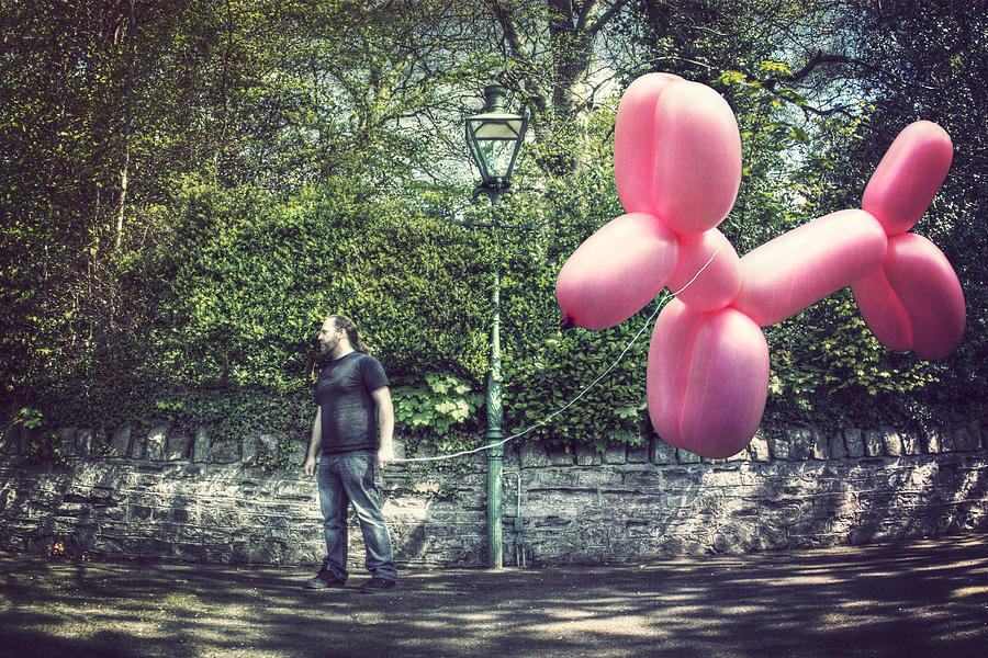 Man with giant balloon dog Photograph by Scott MacBride