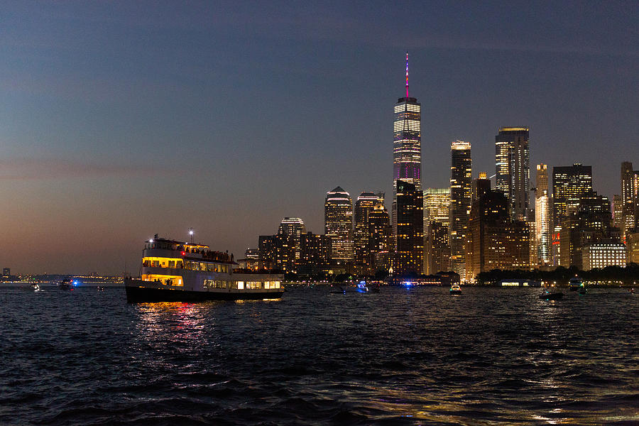 Manhattan skyline at night viewed from the water Photograph by Photographed by Victoria Phipps ©