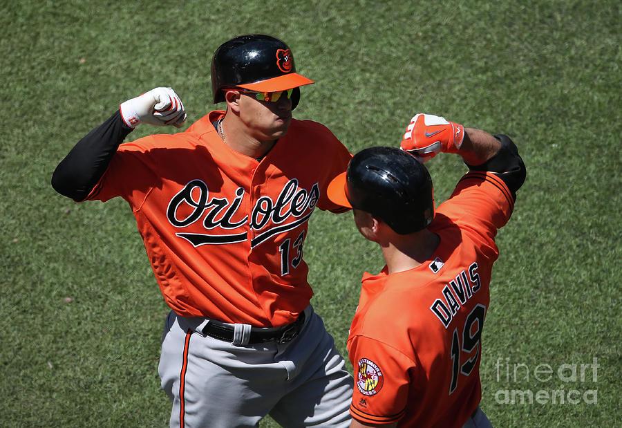Manny Machado and Chris Davis Photograph by Tom Szczerbowski
