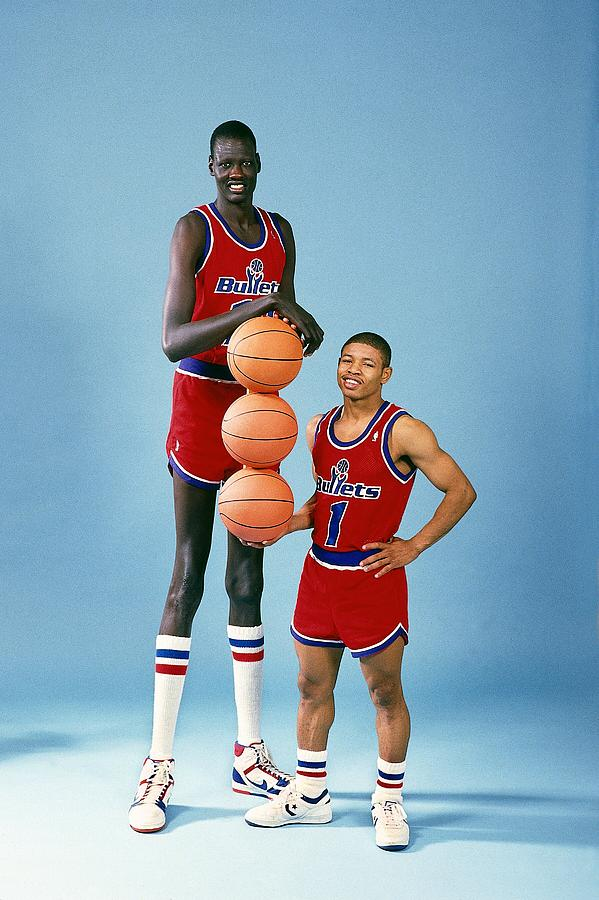 Manute Bol and Muggsy Bogues Photograph by Jerry Wachter