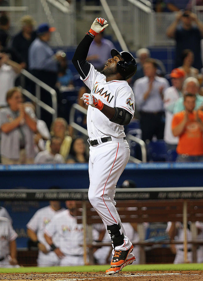 Marcell Ozuna Photograph by Mike Ehrmann