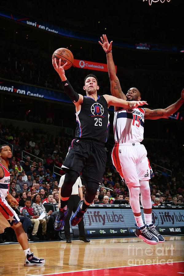 Marcus Thornton and Austin Rivers Photograph by Ned Dishman